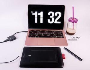 Come impostare lo screensaver con orologio come sfondo sul computer
